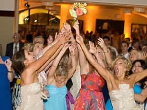 Women catching the bouquet at a wedding