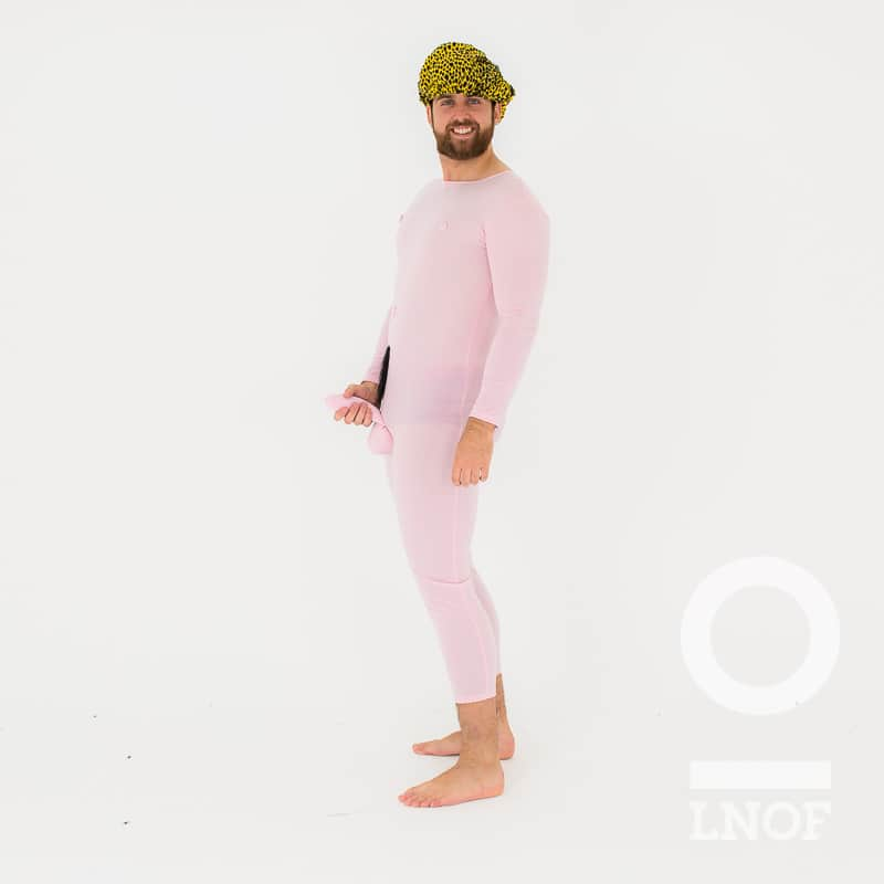 A man in a pink bodysuit with an attached penis, and holding the penis