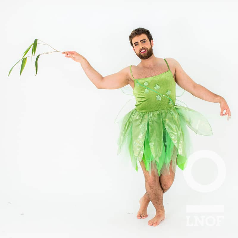 A man dancing in a green Tinkerbell costume