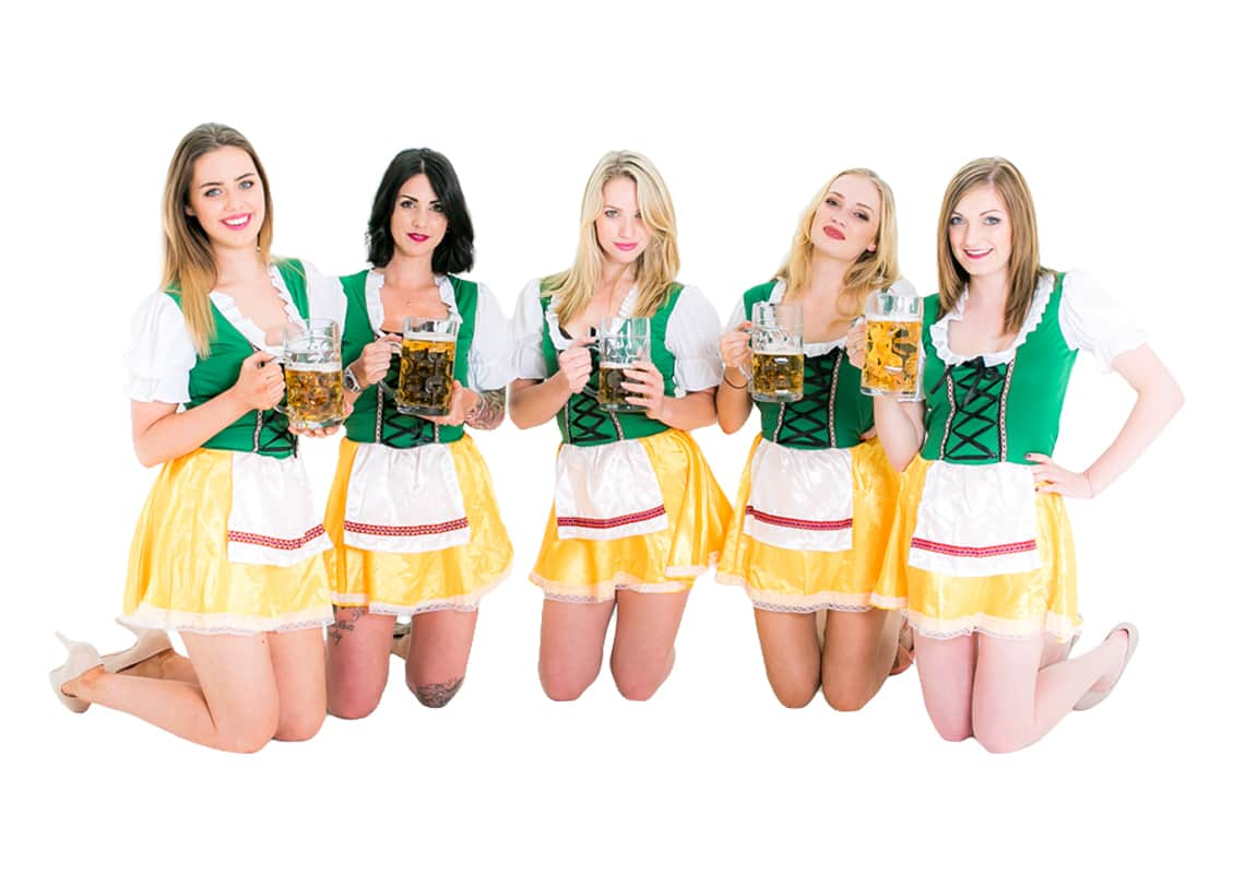 Girls wearing green and yellow Bavarian outfits