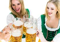 Bavarian girls clinking glasses