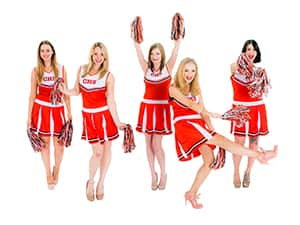Five girls in red and white cheerleader costumes