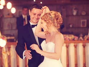 Man in suit dancing with women in wedding dress