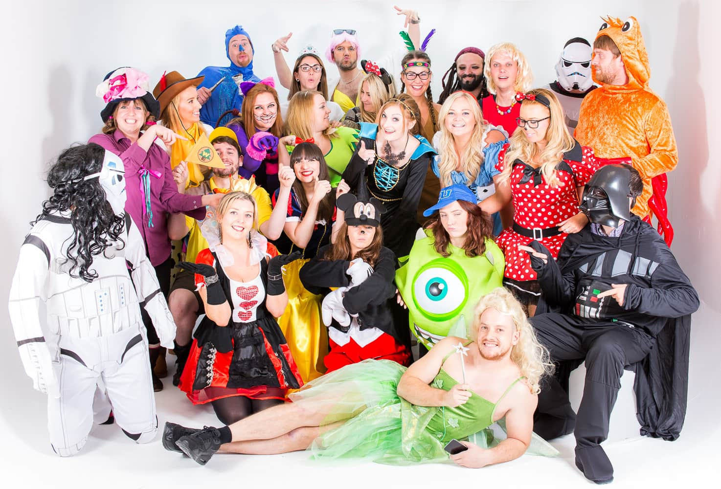 The LNOF team pulling funny poses as they have a group shot in their Disney outfits