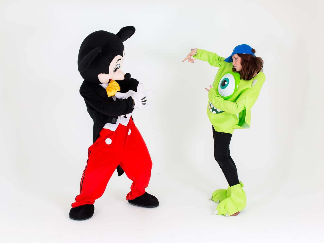 Mike Wazowski and Mickey Mouse having a pose off