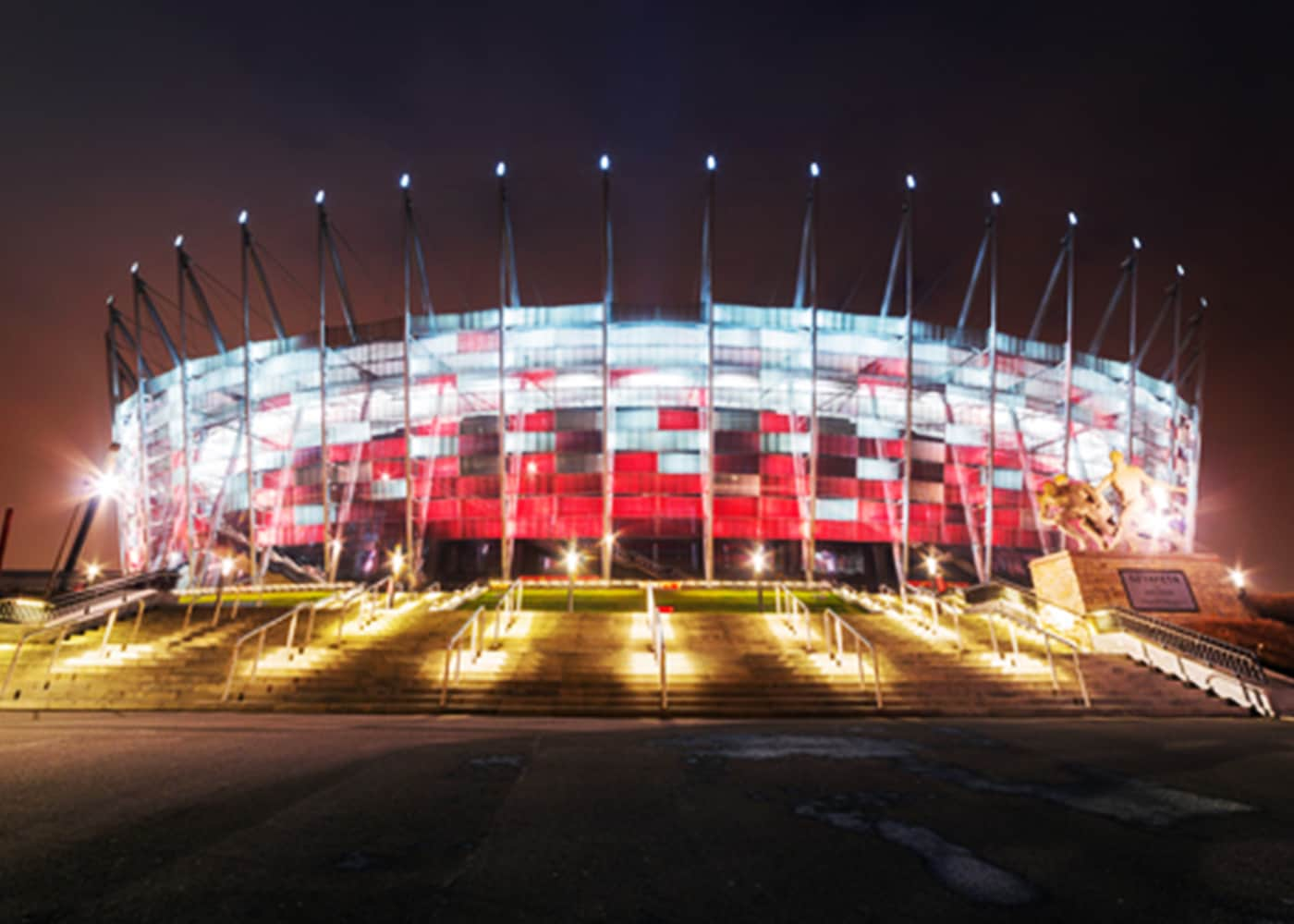 The National Stadium, in Warsaw, lit up at night