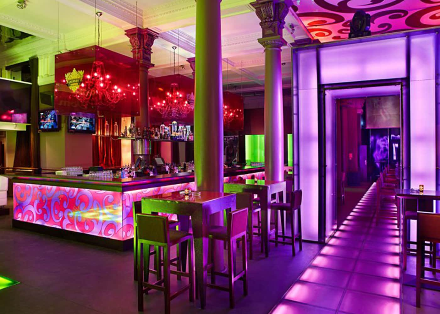 The purple and green interior of Platinum Club, Warsaw