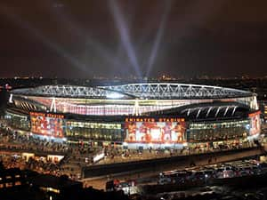 The Emirates Stadium, London, lit up at night