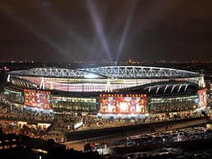 The Emirates Stadium, London, lit up at night