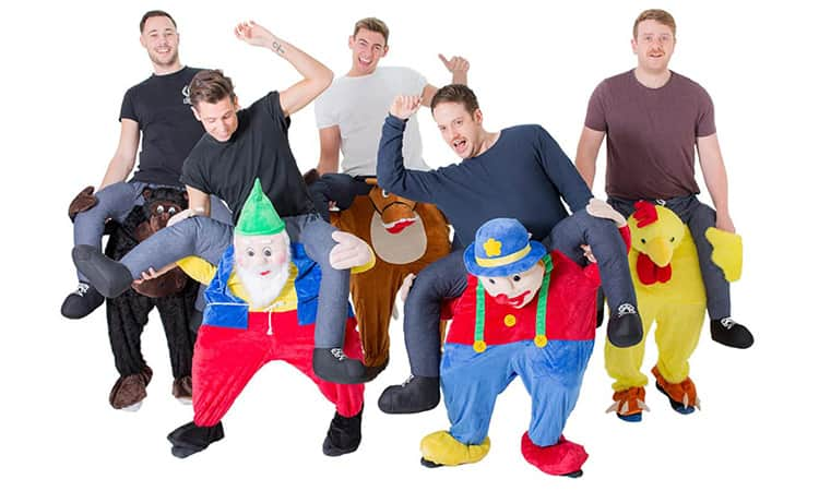 A group of men in Carry Me costumes