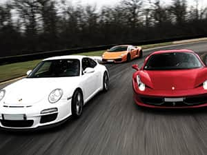 Three supercars racing