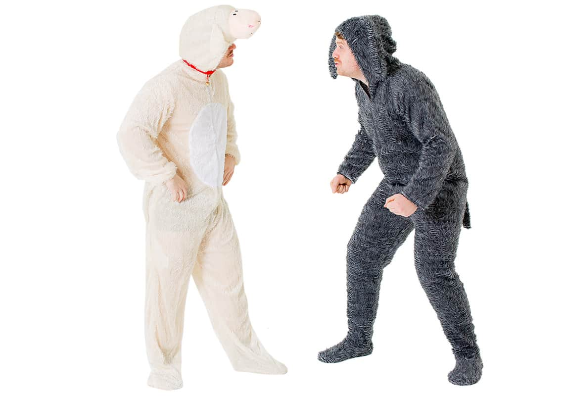 Two men dressed as sheep and a dog looking at each other