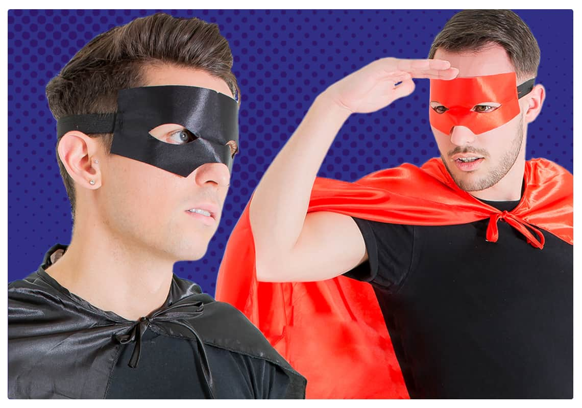 Two men in masks and capes to a blue backdrop
