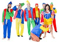 A stag group dressed as Snow White and the seven gnomes