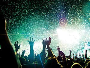 People partying with confetti falling from the air