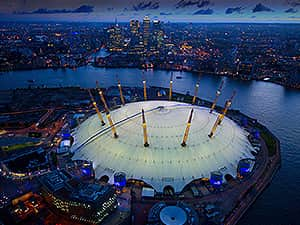 The 02 arena at dusk, with the Thames in the background