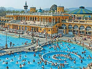 Budapest Turkish Baths exterior and pool, with people in the foreground