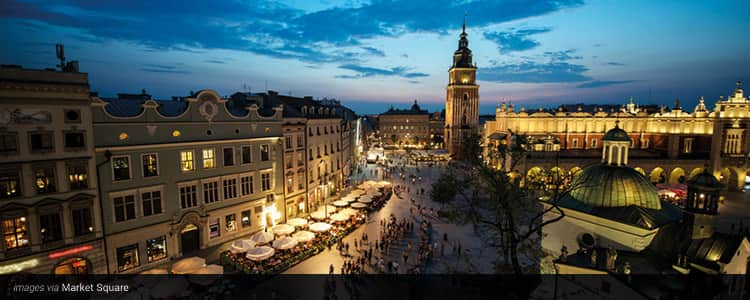 Krakow lit up at dusk, from a bird's eye view