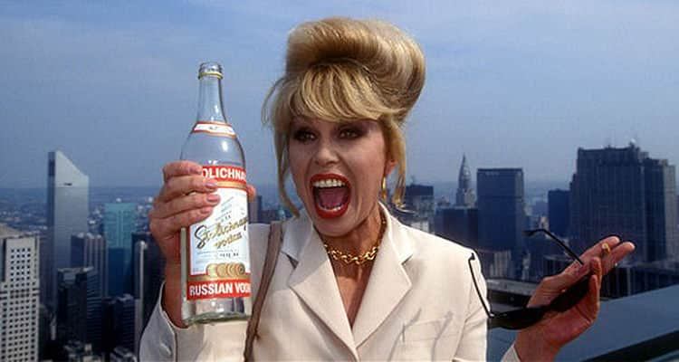 A scene from Absolutely Fabulous, with Patsy holding up a vodka bottle, sunglasses and a cigarette