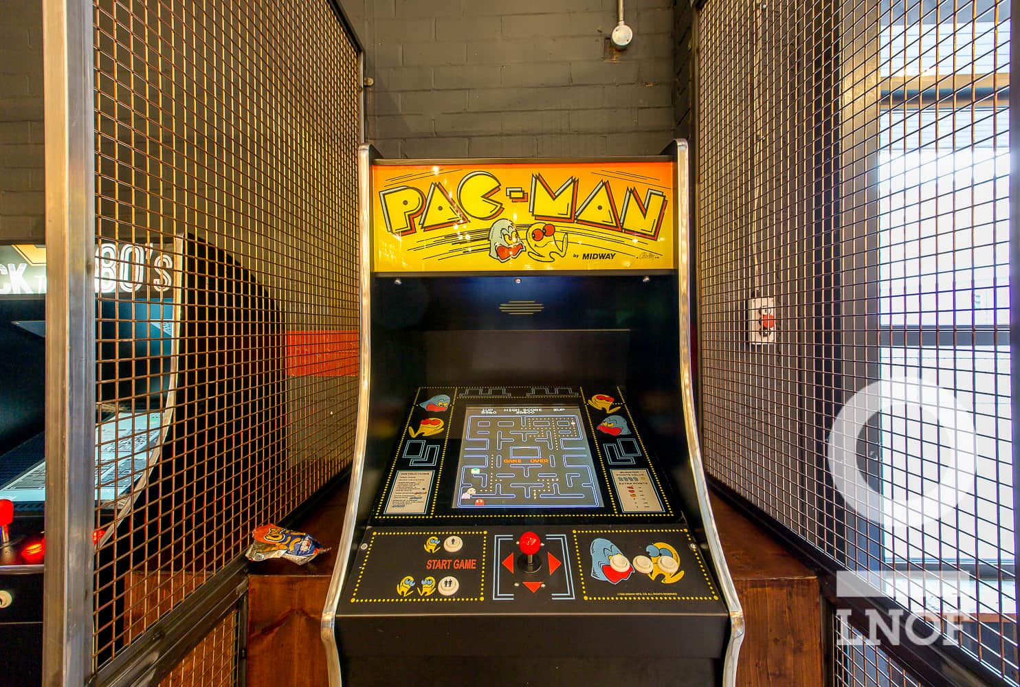 A vintage Pac-Man arcade machine