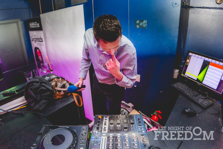 A man looking at DJ decks