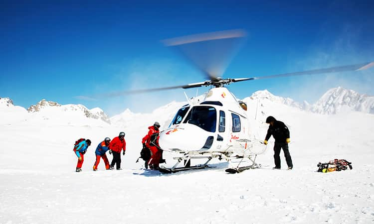 Group getting off a helicopter on the ice of the North Pole.