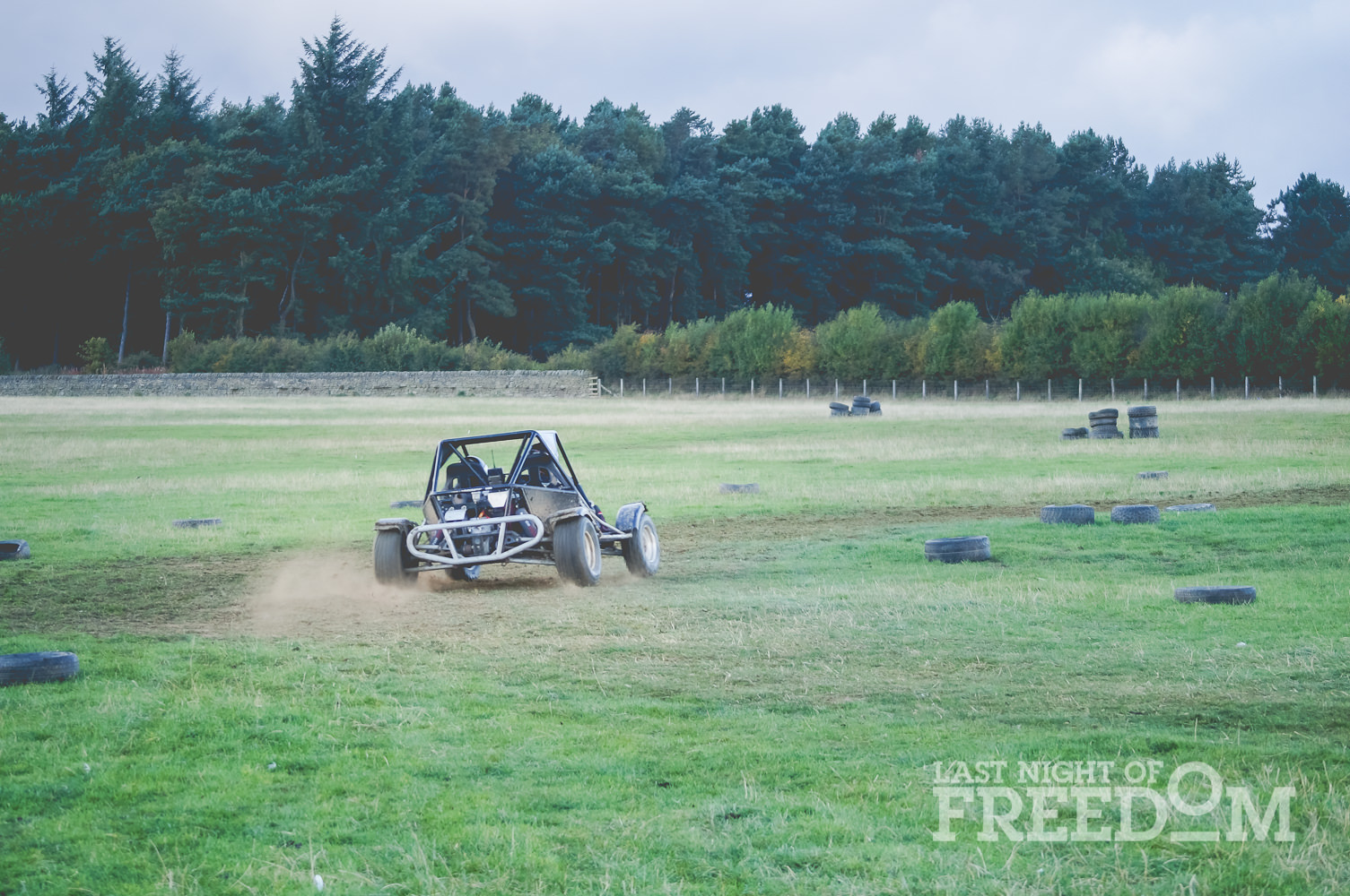 A rage buggy being driven around an outdoor track