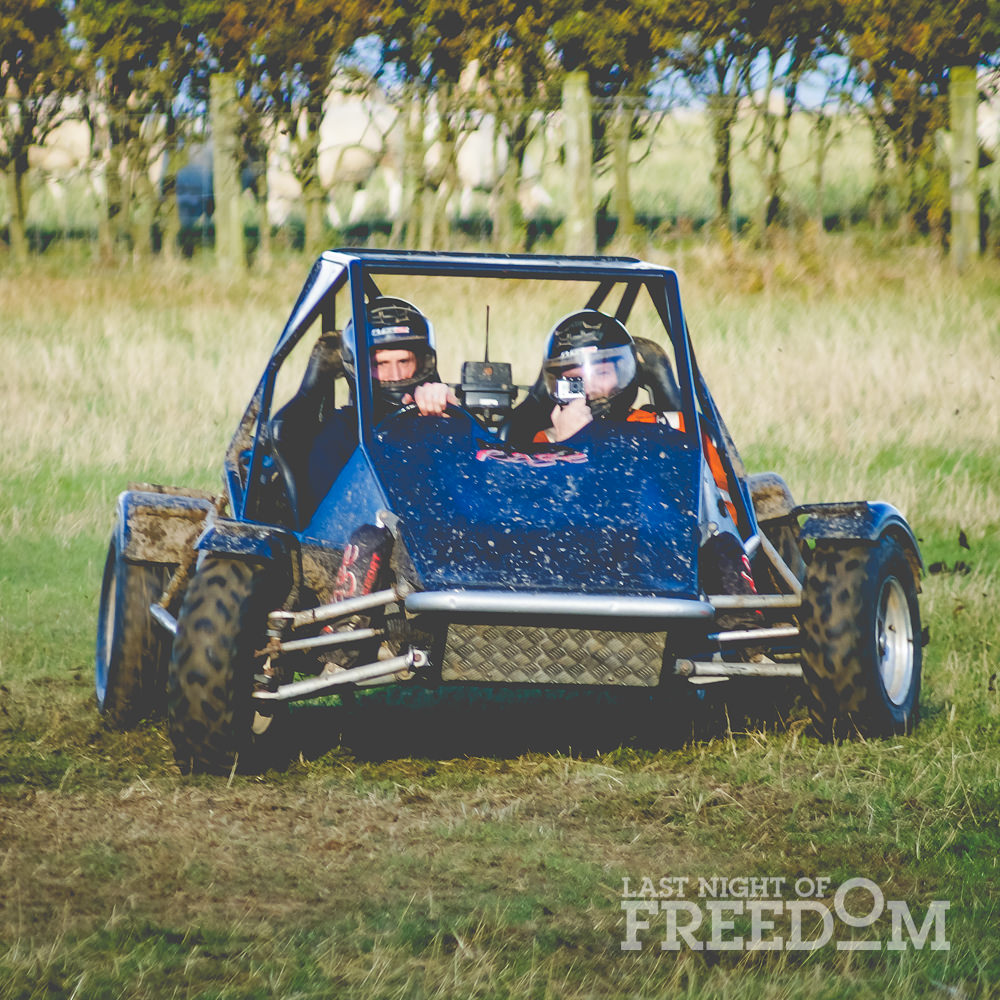 Two people in a blue rage buggy