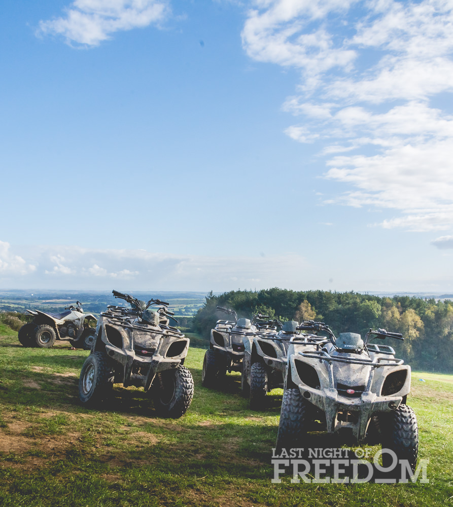 Some quad bikes lined up on the field