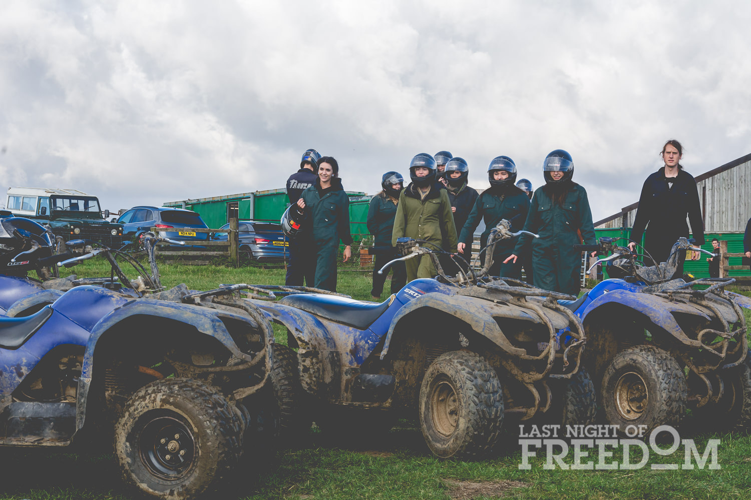 A group of LNOF staff standing around quad bikes