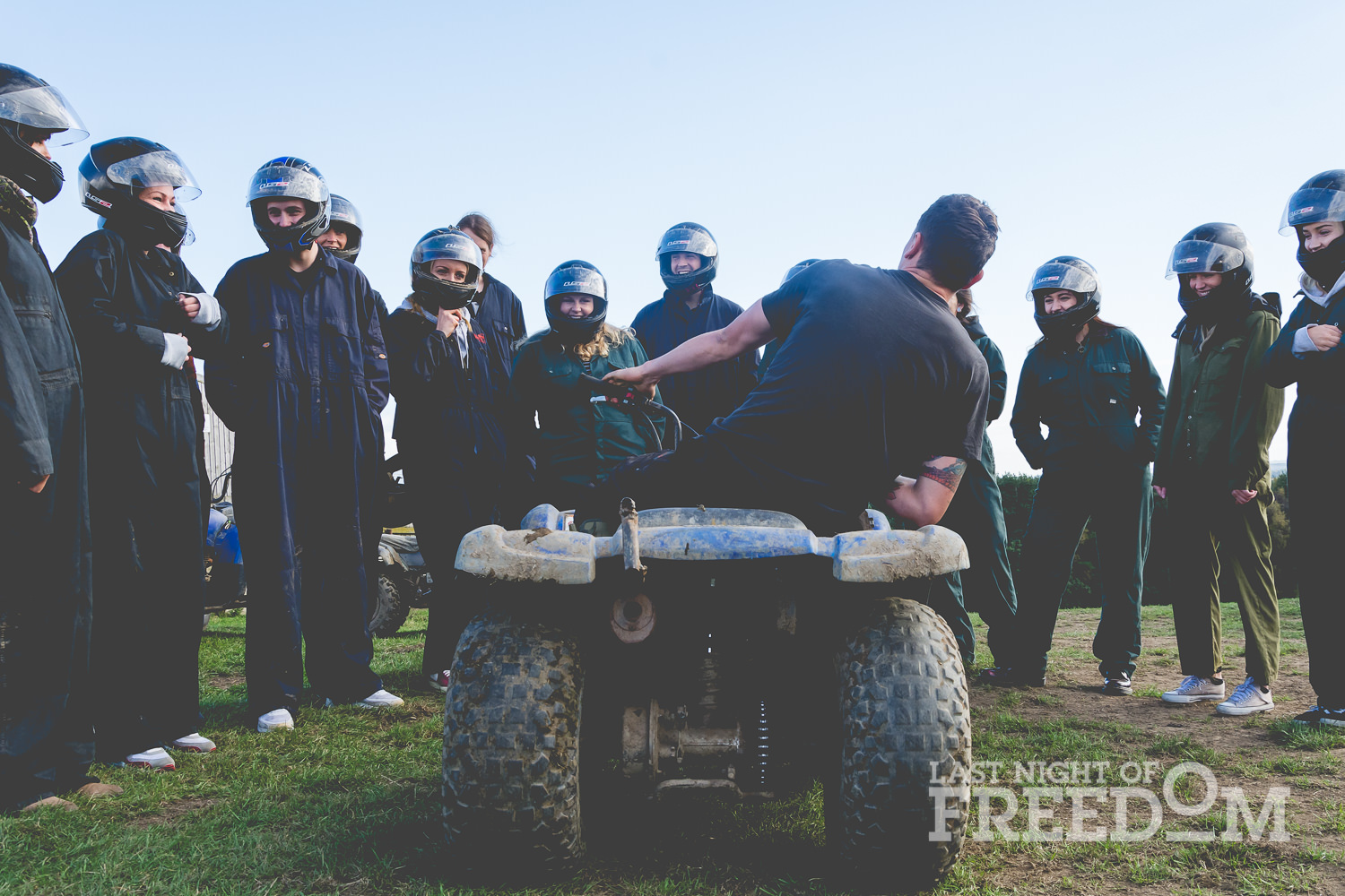A group of LNOF staff listening to a quad bike instructor
