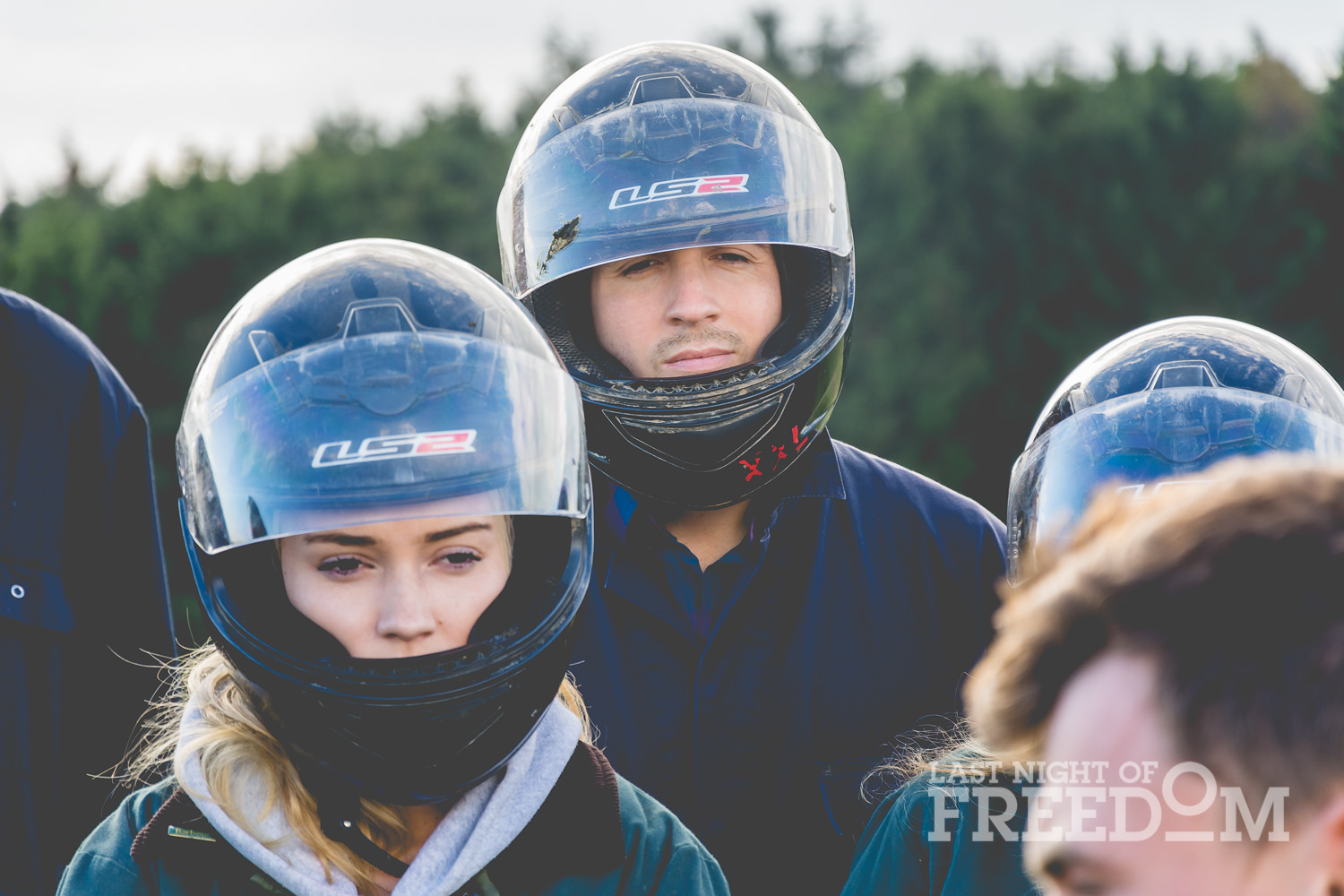 Some people wearing helmets and overalls in a group