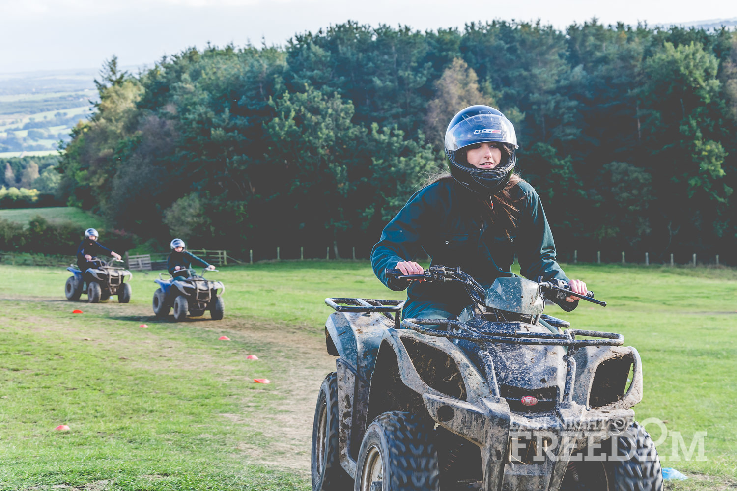 Some of the LNOF team riding quad bikes