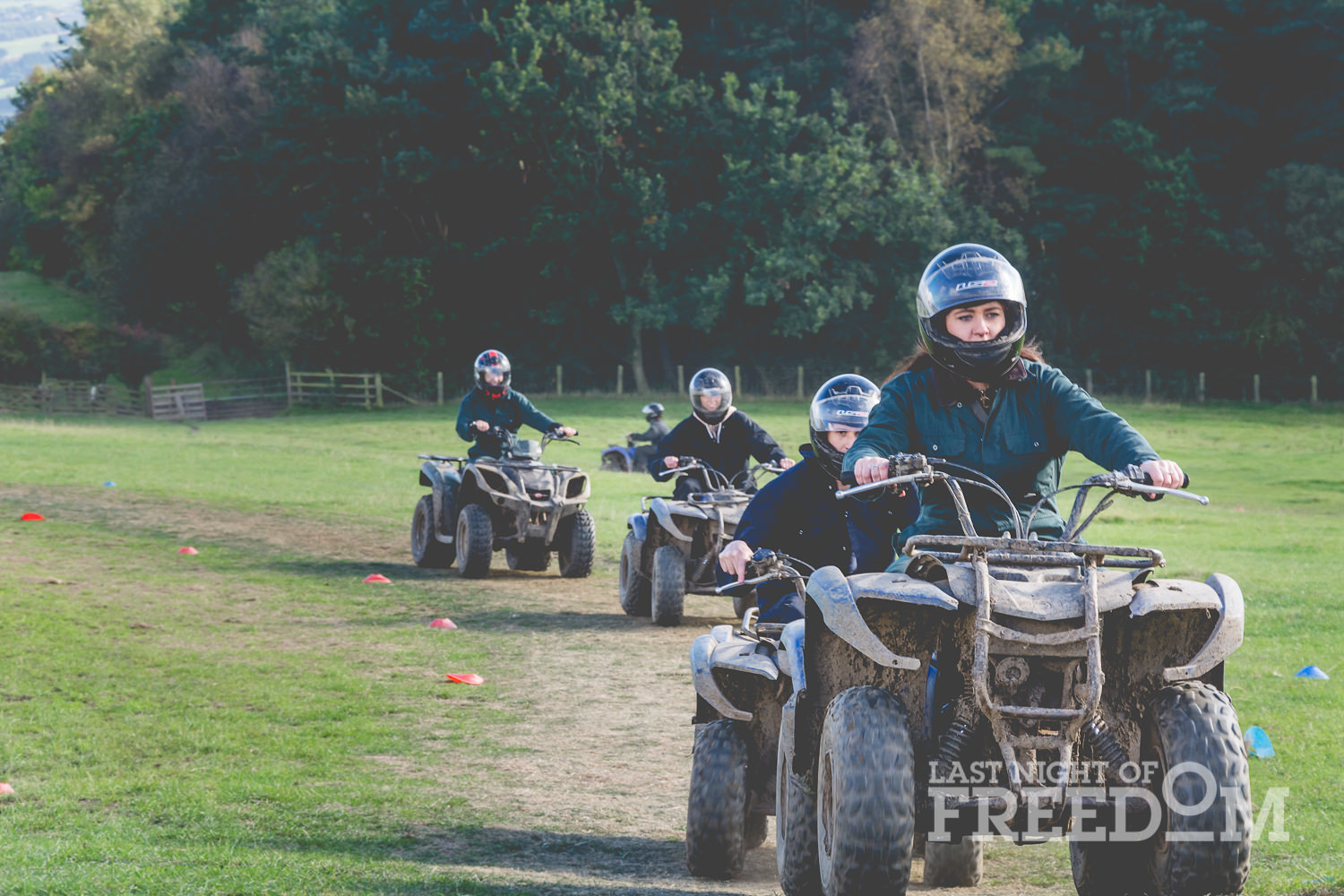 LNOF staff riding quad bikes around a track