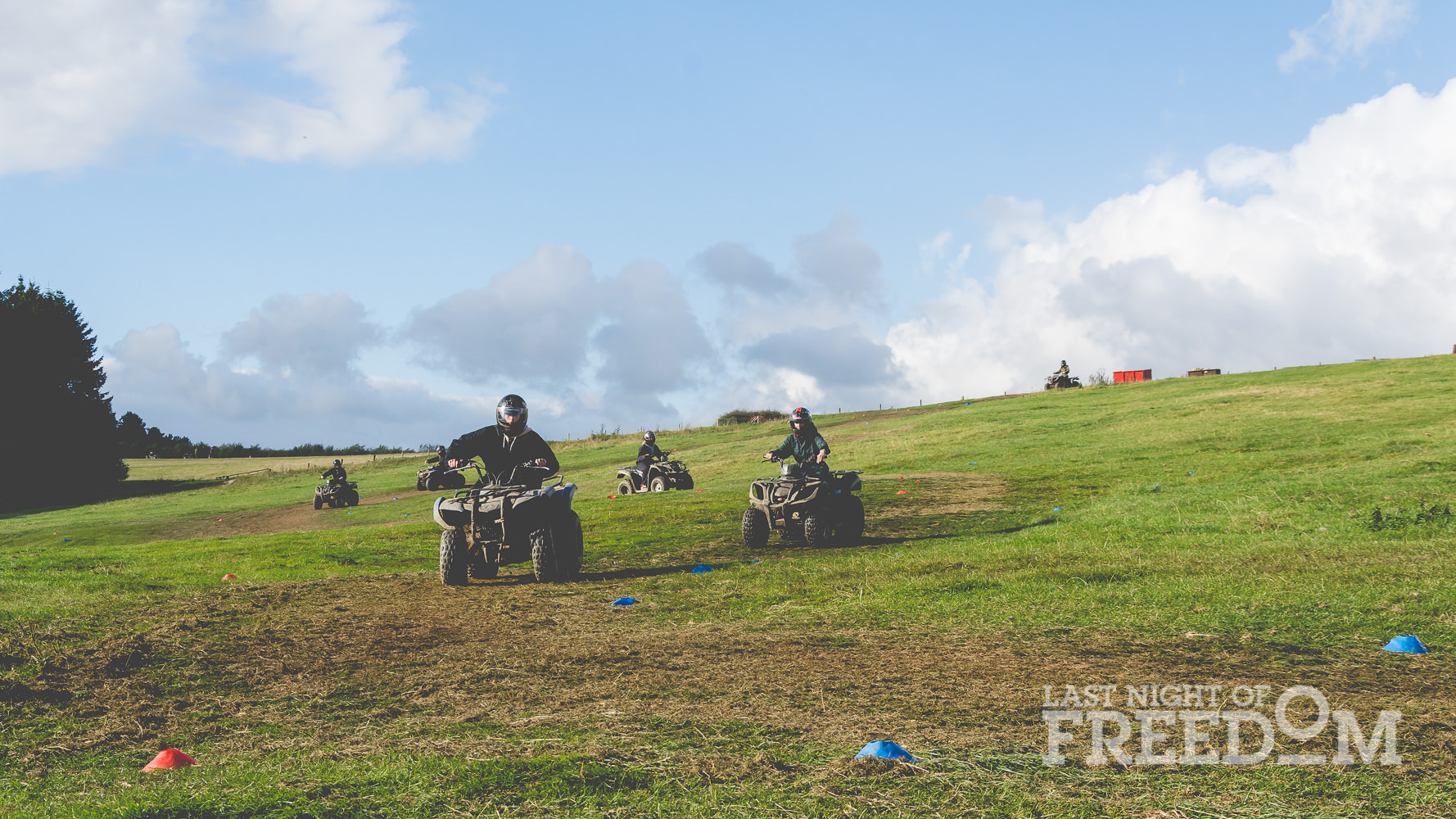 LNOF staff steering quad bikes around a field