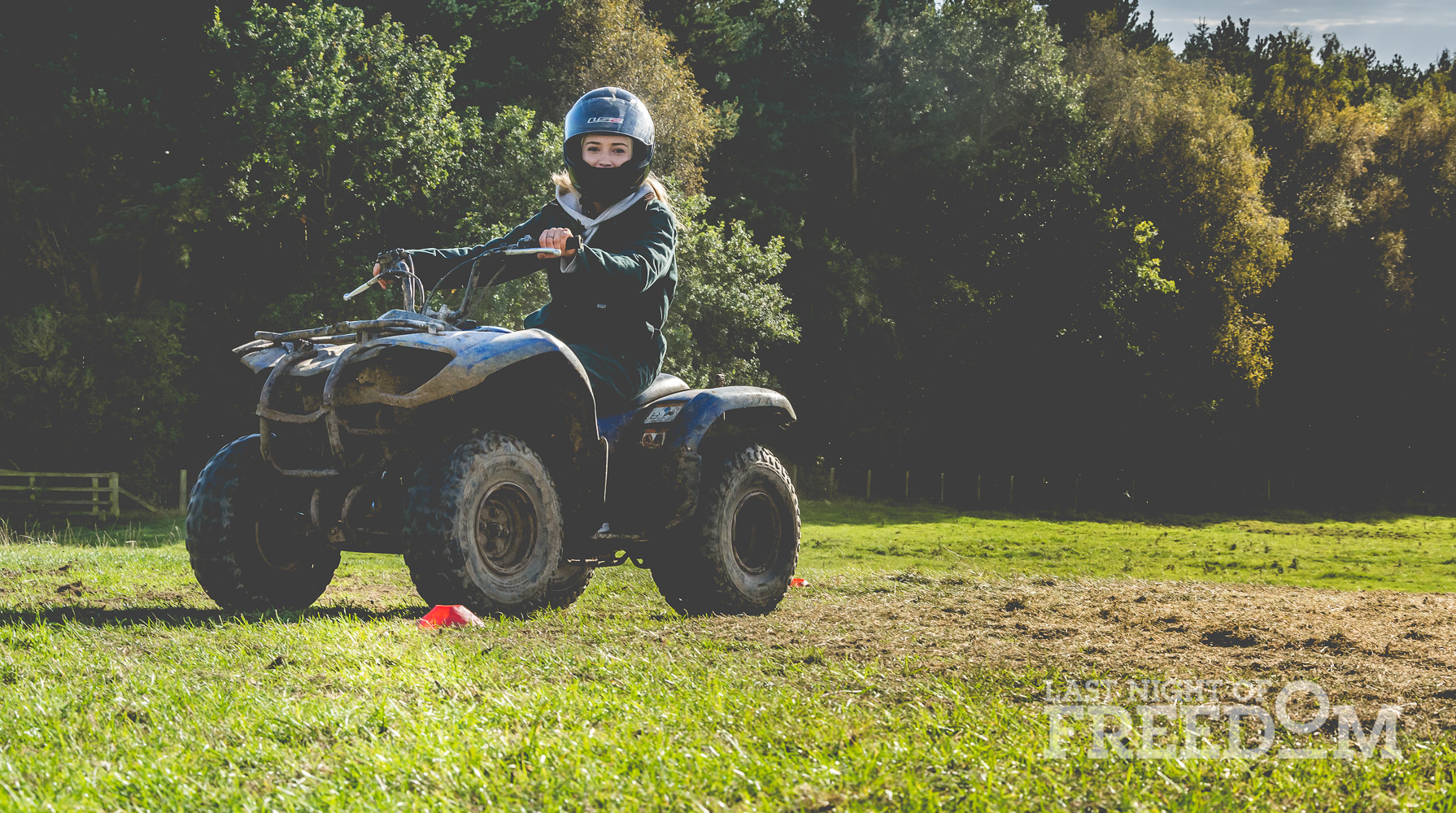 A girl sitting on a quad bike
