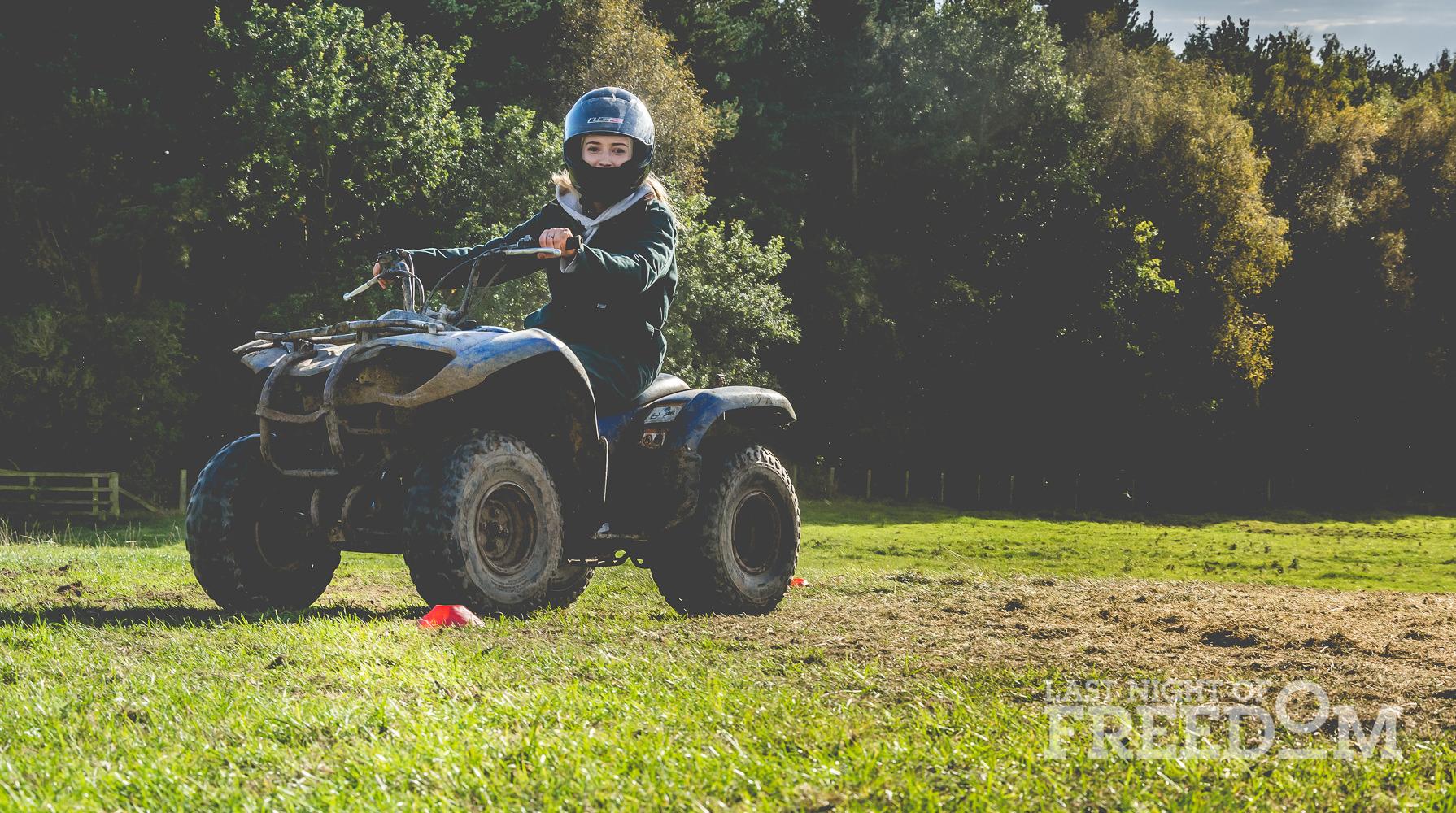 A girl sitting on a quad bike