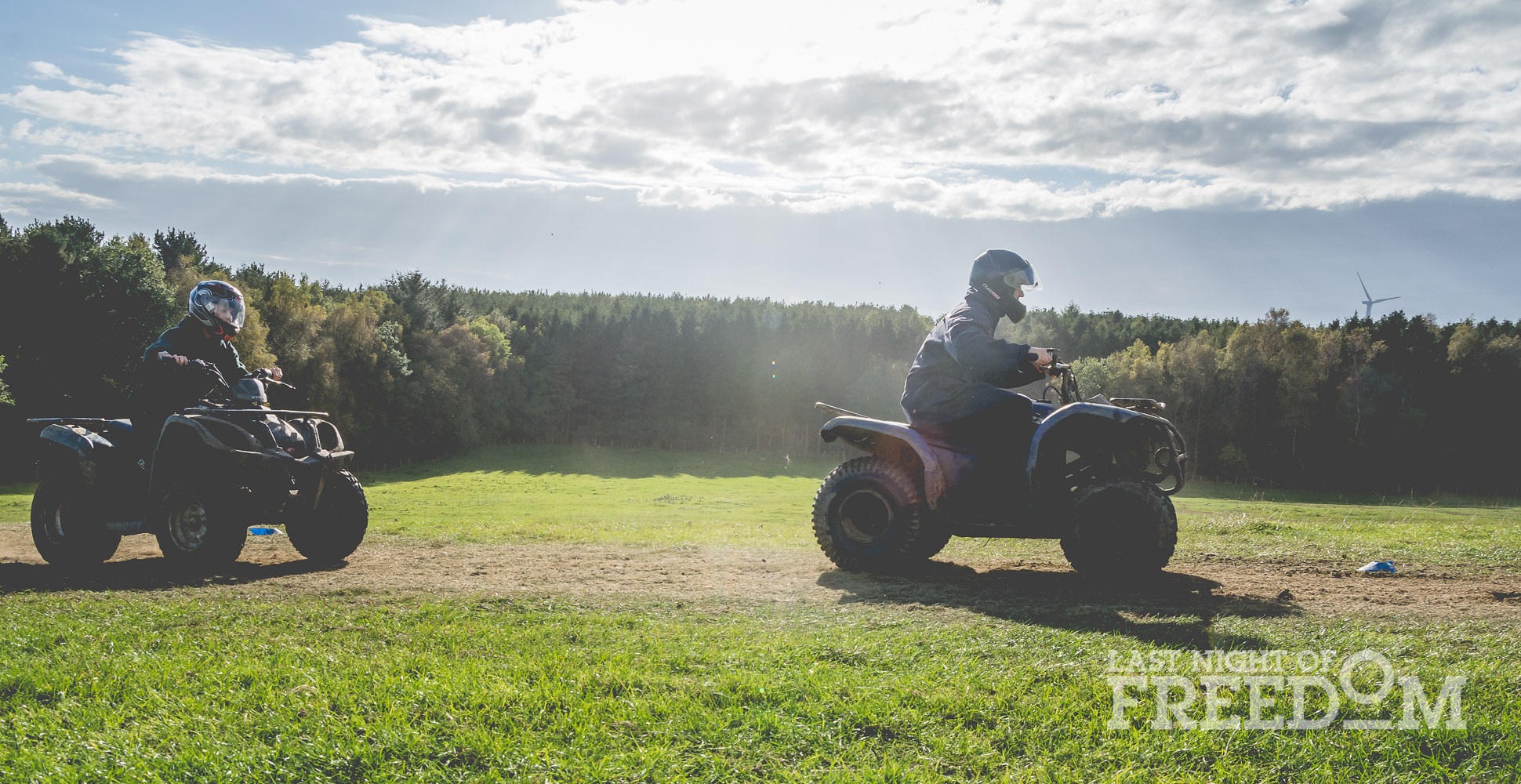 LNOF staff riding quad bikes around a field on a sunny day