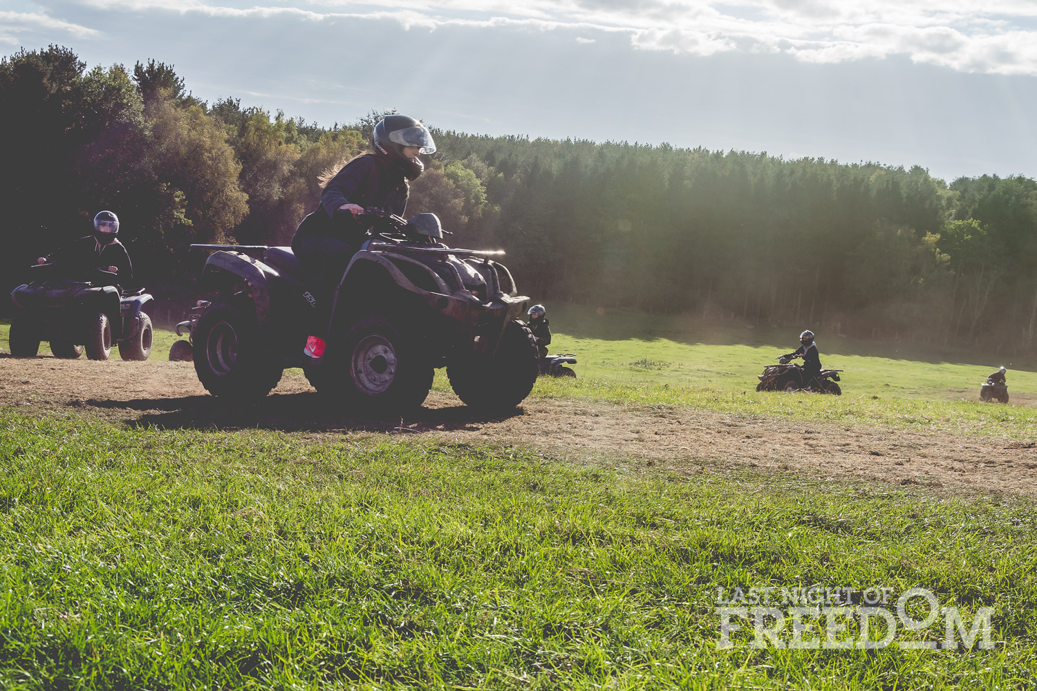 LNOF staff driving quad bikes up a hilly field