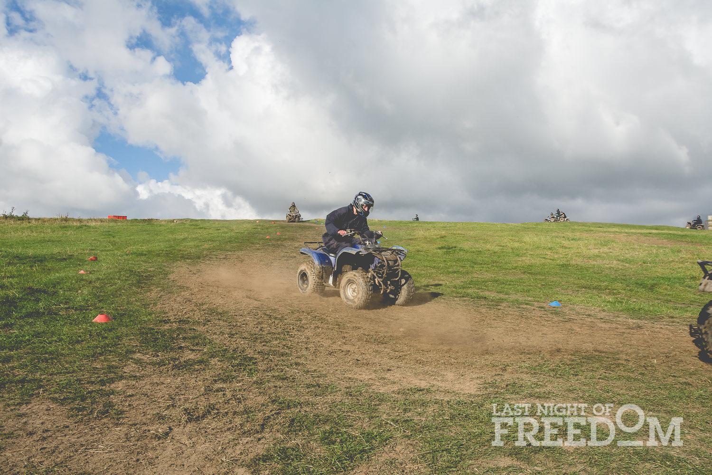 Someone skidding on the mud on a quad bike