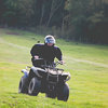 Someone riding a quad bike up a hill towards the camera