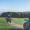 People driving quad bikes around a field