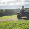 LNOF staff riding quad bikes around a field on a sunny day