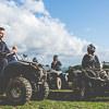 LNOF staff sitting together on quad bikes in a field