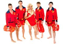 stag wearing fat Pamela Anderson costume with four Baywatch lifeguards