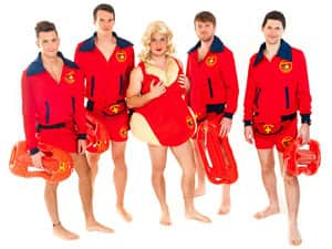 Four men in Baywatch costumes and a man in a drag Baywatch costume