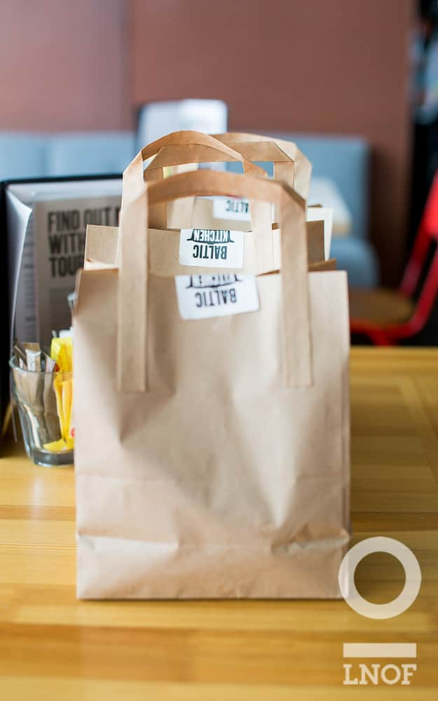 Brown paper bags of takeaway sandwiches at Baltic Kitchen in Newcastle Gateshead