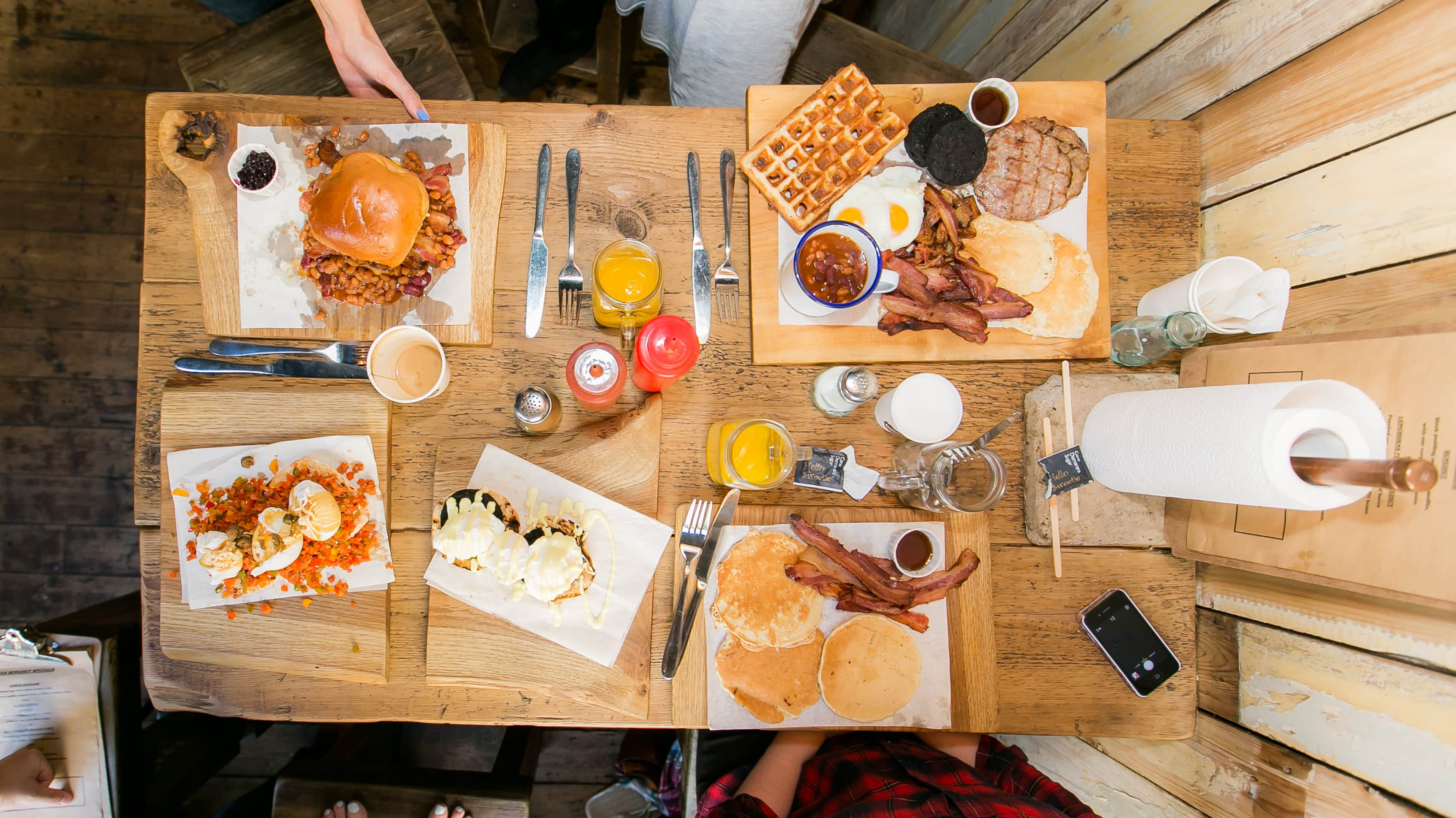Looking down on table full of five different items on the breakfast menu