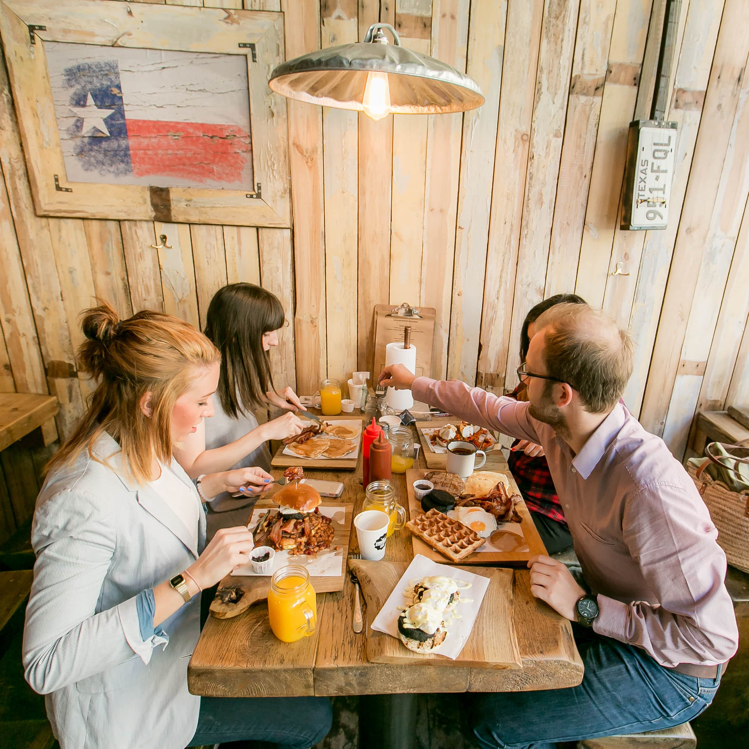 Four LNOF staff tuck into breakfast at Longhorns, Newcastle