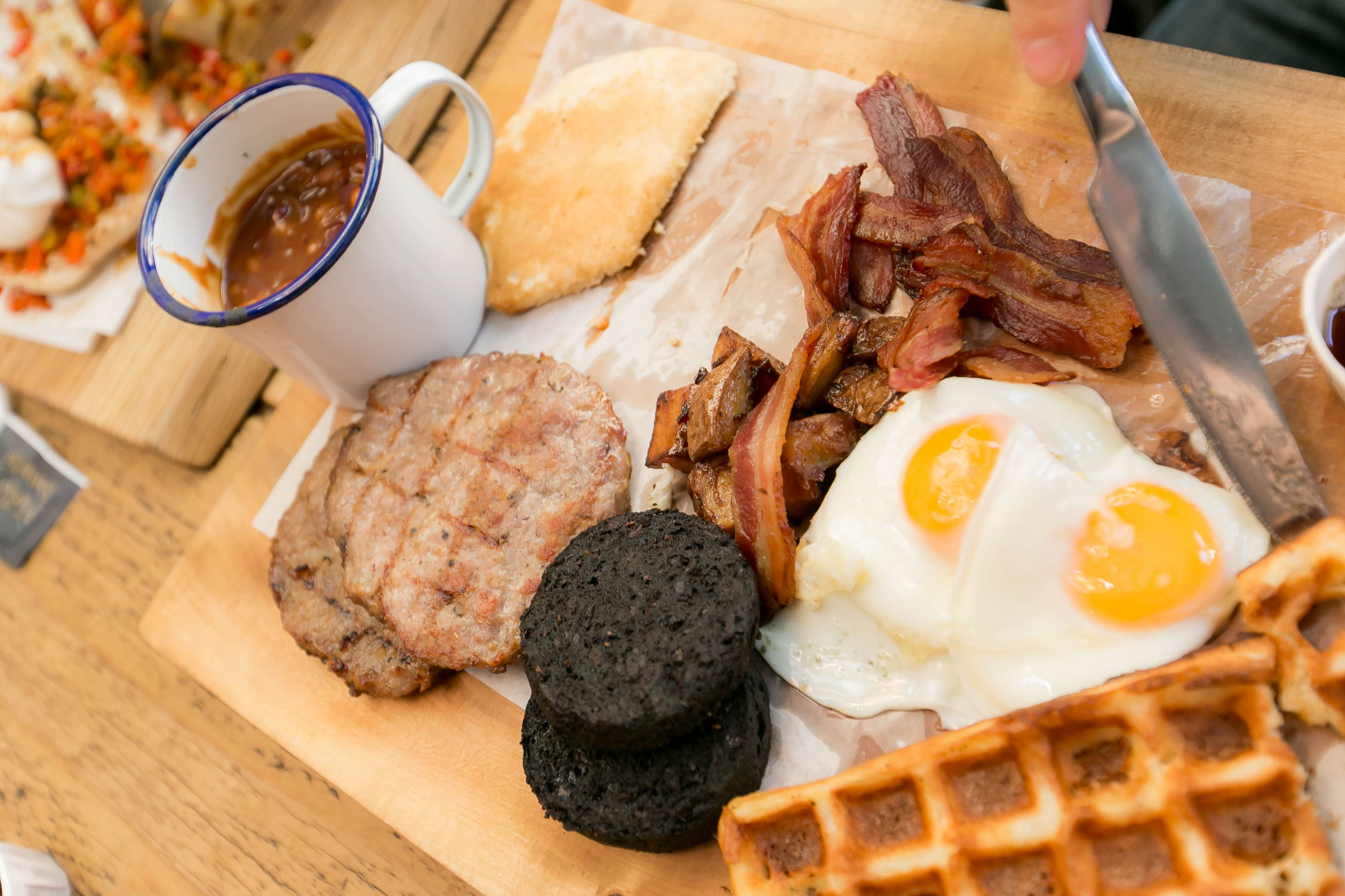 The All In breakfast, featuring bacon, black pudding, waffle, eggs, potato, pancakes and BBQ beans